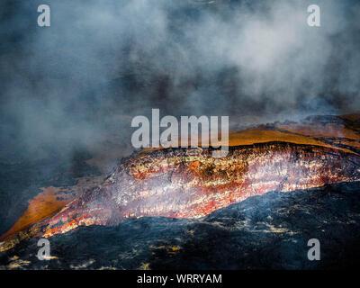 High Angle View Of Smoke Emitting At Kilauea Volcano - Stock Photo