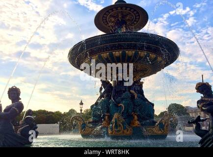 Fountain Of River Commerce And Navigation At Place De La Concorde Against Cloudy Sky - Stock Photo