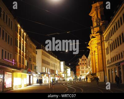 People Walking On Road Along Buildings - Stock Photo