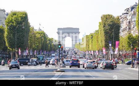 Cars On City Street By Arc De Triomphe Against Clear Sky - Stock Photo