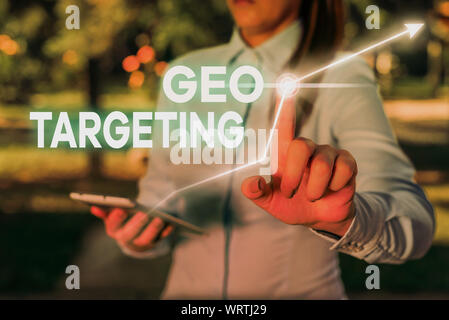 Conceptual hand writing showing Geo Targeting. Concept meaning Digital Ads Views IP Address Adwords Campaigns Location - Stock Photo