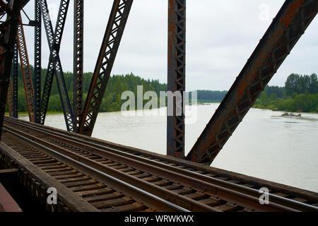 Train bridge over the Talkeetna river in Alaska. - Stock Photo