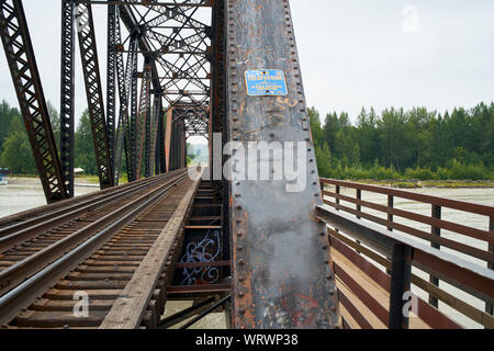 Train bridge over the Talkeetna river in Alaska. - Stock Photo
