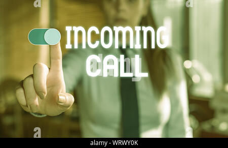 Text sign showing Incoming Call. Business photo showcasing Inbound Received Caller ID Telephone Voicemail Vidcall Blurred woman in the background poin - Stock Photo