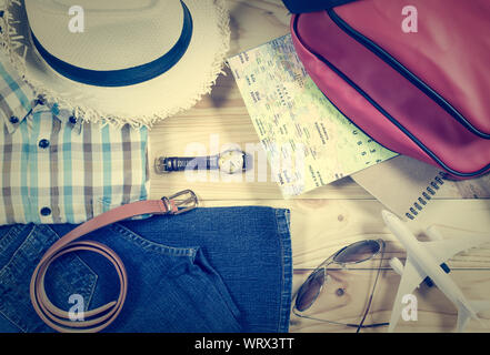 Travel concept with personal accessory on wooden plank in vintage style - Stock Photo