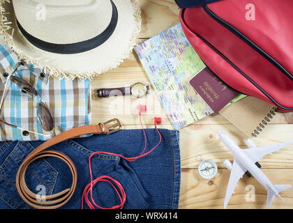 Travel concept with personal accessory on wooden plank - Stock Photo