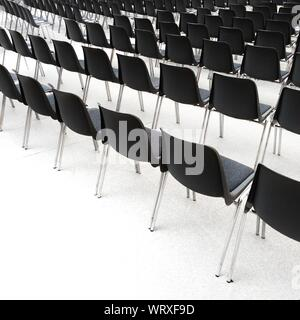 Rows Of Black Chairs On White - Stock Photo