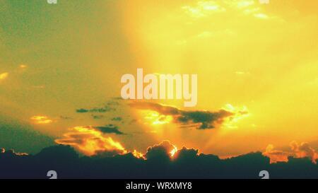 Rays Of Sunlight Break Through Clouds - Stock Photo