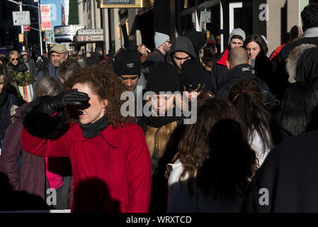 Holiday tourist crowds on 6th avenue new Radio City Music Hall and Rockefeller Center - Stock Photo