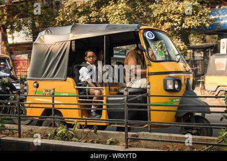 Indian boy commuting to school in Chennai, India - Stock Photo