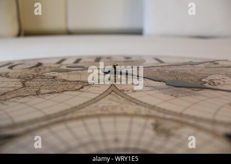 Close-up Of World Map Clock - Stock Photo