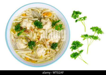 Chicken broth with egg noodles and meatballs. Studio Photo - Stock Photo