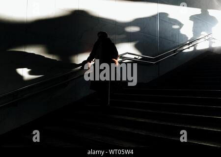 Silhouette Woman Moving Down On Steps - Stock Photo