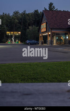 VERONA BEACH, NEW YORK - SEPTEMBER 02, 2019: Night shot of Maple Leaf Market, a convenience store chain and gas station with all day food serving Grab - Stock Photo