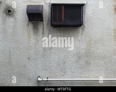 Air Conditioner And Duct With Pipe On Wall - Stock Photo