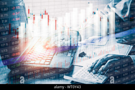 Businessman working with Stock market chart in office. Business trading and technology concept with virtual graphic diagram. - Stock Photo