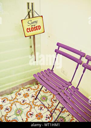 Closed Sign Hanging On Door Of Shop - Stock Photo