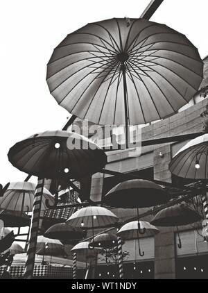 Decorative Umbrellas Hanging At Market Stall - Stock Photo