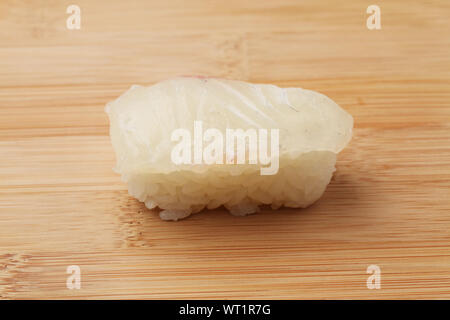 sushi of red snapper closeup isolated on cutting board - Stock Photo