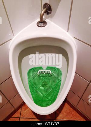 High Angle View Of Urinal In Public Building - Stock Photo