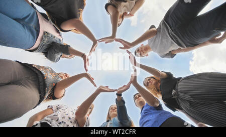 Conceptual symbol of cooperation diverse hands making a circle. - Stock Photo