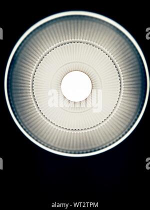 Directly Below View Of Illuminated Pendant Light - Stock Photo