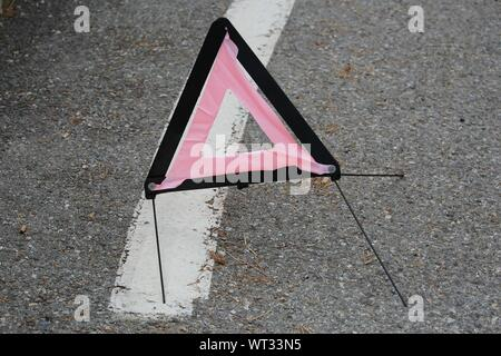 High Angle View Of Warning Triangle On Road - Stock Photo