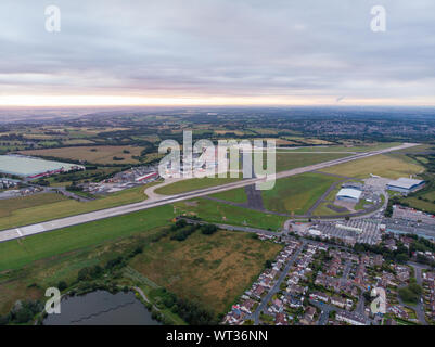Aerial photo of the famous Leeds and Bradford airport located in the Yeadon area of West Yorkshire in the UK, typical British airport showing the runw - Stock Photo