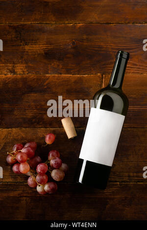 Flat lay mockup with wine bottle, cork and red grape. From above image, vertical composition. - Stock Photo