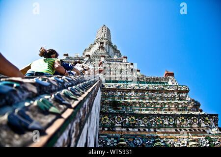 Tourists Climbing Up Wat Arun Temple - Stock Photo