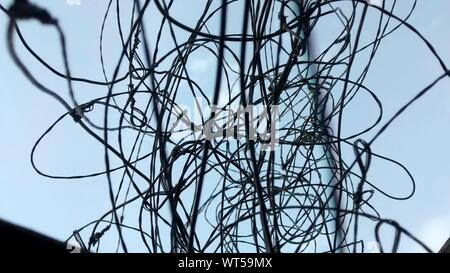 Low Angle View Of Wire Mesh Against Sky - Stock Photo