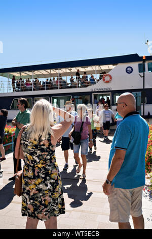 People waiting for the ferry Lake Garda Italy - Stock Photo