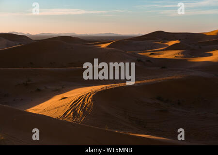 Gorgeous and scenic desert sunset scene above beautiful sand dunes Erg Chebbi, Morocco, Merzouga - Stock Photo