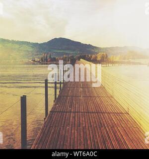 Wooden Bridge Over Lake - Stock Photo
