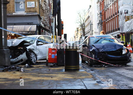 AUTHENTIC IMAGERY. CAR CRASH IN LONDON'S WEST END. BAD DRIVING. REAL THINGS. REAL PLACES. REAL PEOPLE. HONEST IMAGERY. HEARTFELT IMAGERY. NEWS TYPE IMAGERY. AFTERMATH IMAGERY. CONSEQUENCES OR AFTER EFFECTS OF A SIGNIFICANT UNPLEASANT EVENT. ACCIDENT. ACCIDENTAL EVENTS. ROAD SAFETY. AUTHENTIC IMAGERY ON alamy.com - Stock Photo