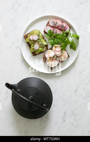 High Angle View Of Open Sandwiches In Plate On Table - Stock Photo