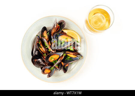 Marinara mussels, moules mariniere, shot from the top on a white background with a glass of wine and a place for text - Stock Photo