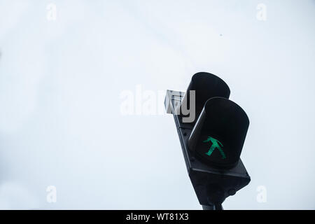 Pedestrian green light on a traffic light, abiding by the Serbian and European traffic regulations, letting walking people crossing a crosswalk and a - Stock Photo