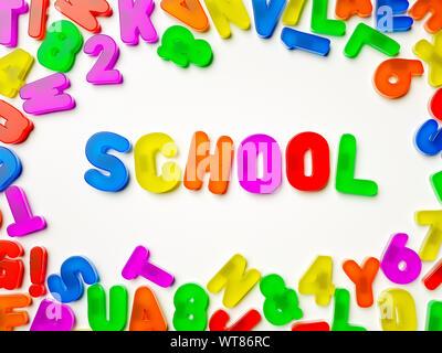 Plastic multi coloured fridge magnet alphabet spelling School - Stock Photo