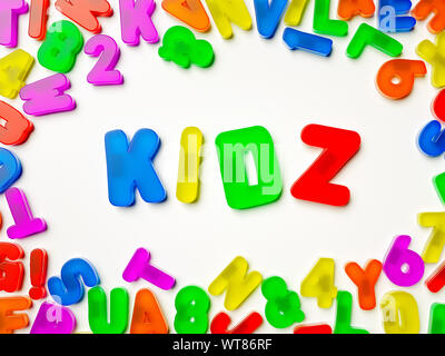 Plastic multi coloured fridge magnet alphabet spelling Kidz - Stock Photo