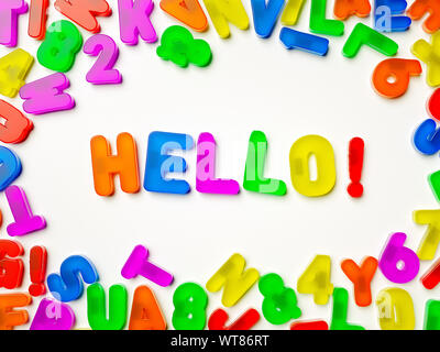 Plastic multi coloured fridge magnet alphabet spelling Hello! - Stock Photo
