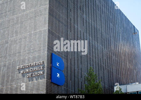 LYON, FRANCE - JULY 13, 2019: Bibliotheque Municipale de Lyon main building in Part Dieu with its logo. It is the Lyon Public Library, hosting various - Stock Photo