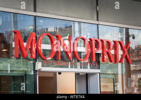 LYON, FRANCE - JULY 19, 2019: Logo of Monoprix in front of their local supermarket for downtown Lyon. Monoprix is a French chain of convenience stores - Stock Photo