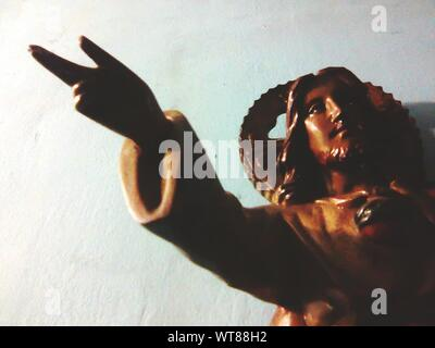 Close-up Of Jesus Christ Sculpture Against Wall - Stock Photo
