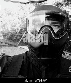 Close-up Of Man Wearing Paintball Mask - Stock Photo