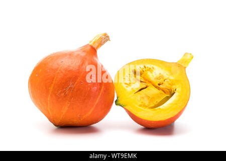 Whole and half Red Kuri squash isolated on white background - Stock Photo