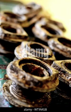 Old Rusty Nuts With Bolts On Metallic Surface - Stock Photo