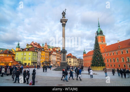Warsaw, Poland - 03.01.2019: Royal Castle, ancient townhouses and Sigismund's Column in Old town in Warsaw, Poland. New Year. Travel.