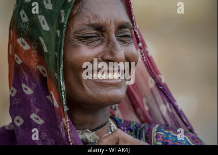 Smiling Rajasthani`s woman with traditional clothes - Stock Photo