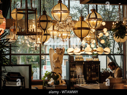 Trendy hipster interior decor at The Dining Room, Mare Street Market, Hackney, East London UK. Chandeliers by Pure White Lines. - Stock Photo
